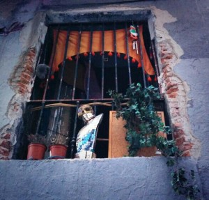 Decorated window in a Squatters house.